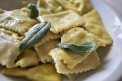 Ravioli pasta with butter and sage. Served in italy stock photo