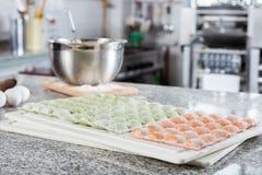 Ravioli Pasta On Cutting Board At Countertop In Royalty Free Stock Photos