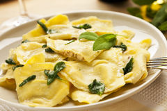 Ravioli pasta filled with truffles and porcini Stock Photography