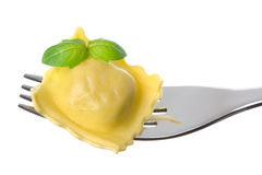 Ravioli Pasta Parcel And Basil Garnish On Fork Stock Image