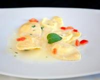 Ravioli pasta with red tomato Royalty Free Stock Photos