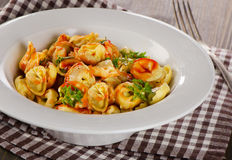 Ravioli pasta with  sauce and herbs. Stock Images