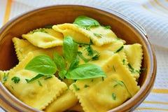 Ravioli pasta. Stuffed with porcini mushrooms in bowl Royalty Free Stock Photo