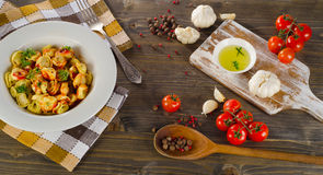 Ravioli pasta with  tomato sauce and fresh herbs. Top view Stock Photography