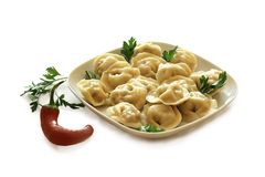 Ravioli with pepper and fresh herbs. Stock Images