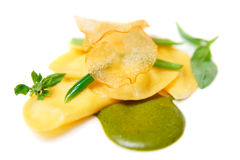 Ravioli with pesto sauce and potato chips isloated on white Royalty Free Stock Image