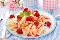 Ravioli (pierogi) with cheese and raspberry Royalty Free Stock Image