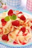 Ravioli (pierogi) with cheese and raspberry Stock Photos