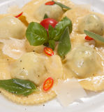 Ravioli with red chily pepper and sweet basil Royalty Free Stock Photos
