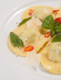 Ravioli with red chily pepper and sweet basil Stock Photography