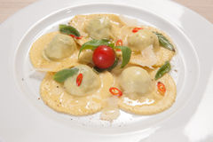Ravioli with red chily pepper and sweet basil Royalty Free Stock Image