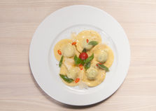 Ravioli with red chily pepper and sweet basil Stock Images