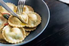 Ravioli with ricotta cheese, yolks quail eggs and spinach with spices.  Royalty Free Stock Images