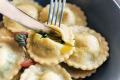 Ravioli with ricotta cheese, yolks quail eggs and spinach with spices.  Stock Images