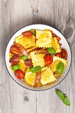 Ravioli with ricotta, tomatoes and basil Stock Photo