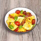 Ravioli with ricotta, tomatoes and basil Stock Photography