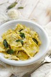 Ravioli with sage butter sprinkled with grana padano cheese. Traditional Italian meal, ravioli with sage butter stock photography