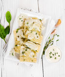 Ravioli with spinach and ricotta cheese on white plate. On wooden background Stock Photos