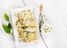 Ravioli with spinach and ricotta cheese with white sauce Royalty Free Stock Images
