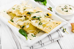 Ravioli with spinach and ricotta cheese with white sauce Stock Photo