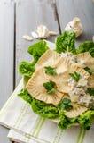 Ravioli stuffed with mushrooms and ricotta Stock Image