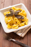 Ravioli stuffed to artichokes with butter and sage Royalty Free Stock Photography
