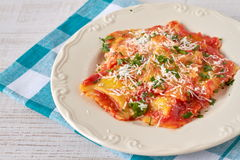 Ravioli with tomato sauce and parmesan Stock Images