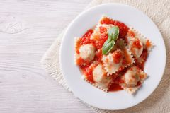 Ravioli with tomato sauce on a plate. horizontal top view Stock Photos