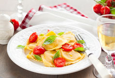 Ravioli with tomatoes and basil Royalty Free Stock Image