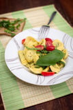 Ravioli with tomatos and basil Royalty Free Stock Images