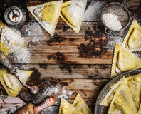 Ravioli  Triangoli making, preparation on rustic wooden background, top view. Royalty Free Stock Images