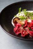 Ravioli vermelho com cogumelos Foto de Stock
