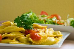 Raviolii and salad Royalty Free Stock Image