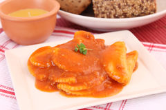 Raviolis. Some fresh raviolis with a sauce of tomatoes Royalty Free Stock Images