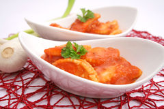 Raviolis. Some fresh raviolis with a sauce of tomatoes Stock Images