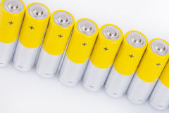 Raw of AA alkaline batteries Royalty Free Stock Image