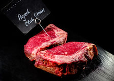 Raw aged slice of angus beef steak with sign. royalty free stock photo