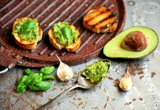 Raw ,alkaline food with avocado and basil pesto with garlic Royalty Free Stock Image