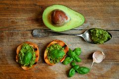 Raw ,alkaline food with avocado and basil pesto with garlic Stock Photos