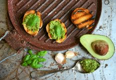 Raw ,alkaline food with avocado and basil pesto with garlic stock images