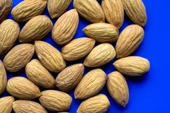 Raw Almonds. Closeup of raw almonds on a blue plate Stock Images