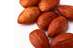 Raw almonds against a white background. Closeup of multiple raw almond nuts Stock Images