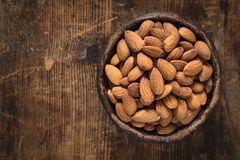 Raw almonds in bowl, top view Stock Images