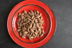 Raw almonds in plate Stock Image