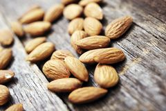 Raw Almonds on Wood Royalty Free Stock Photography
