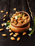 Raw almonds on wooden bowl, selective focus, space for text Stock Photos