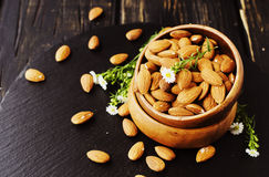Raw almonds in a wooden bowl selective focus Royalty Free Stock Images
