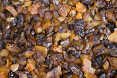 Raw amber background. Small pieces of raw amber on a market Royalty Free Stock Image