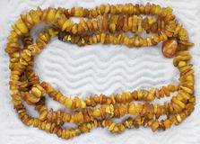 Raw amber necklace Royalty Free Stock Photos