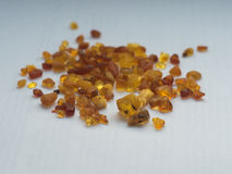 Raw amber stones in different colors isolated on white Royalty Free Stock Photo
